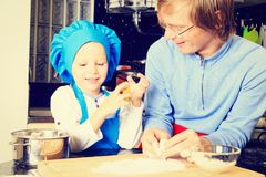 Father and son cooking in kitchen Royalty Free Stock Images