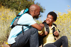 Father and son on country hike Royalty Free Stock Images