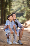 Father and son on country walk. Admiring something off camera Royalty Free Stock Images