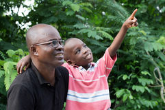 Father and son in countryside Stock Photography