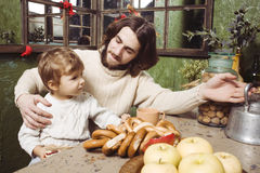 Father with son at countryside kitchen Stock Photos