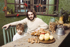 Father with son at countryside kitchen Royalty Free Stock Photo
