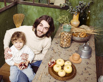Father with son at countryside kitchen Stock Photo