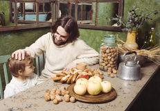Father with son at countryside kitchen Royalty Free Stock Photography