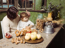 Father with son at countryside kitchen Stock Image