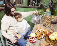 Father with son at countryside kitchen Royalty Free Stock Images