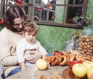 Father with son at countryside kitchen Royalty Free Stock Image