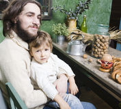 Father with son at countryside kitchen Stock Photography