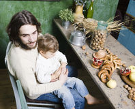 Father with son at countryside kitchen Stock Images