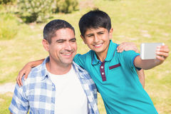 Father and son in the countryside taking selfie Royalty Free Stock Image