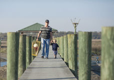 Father and son with crab trap Stock Photo