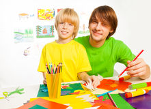 Father and son crafting Stock Images
