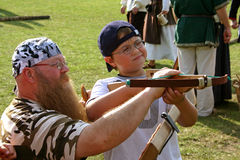 Father and Son with a crossbow Stock Photography