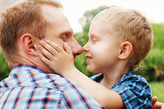 Father and son cuddle Stock Photos