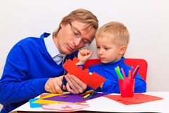 Father and son cutting from paper Royalty Free Stock Photography