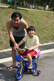 Father & son cycling Royalty Free Stock Photography