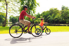 Father and son cycling Royalty Free Stock Photography