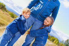 Father, son and daughter. Dressed in jeans Royalty Free Stock Photo
