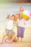 Father with son and daughter on beach Stock Photography