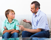 Father and son discussing serious Stock Image