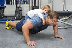 Father and son do sports. In the gym stock images