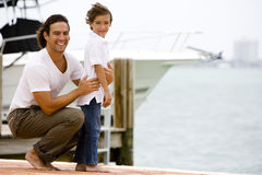 father and son on dock in marina Stock Images