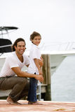 father and son on dock in marina Stock Photos