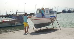 Father and son on the docks with boats stock footage