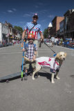 Father, son and dog celebrate July 4, Independence Day Parade, Telluride, Colorado, USA Stock Photography