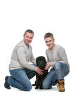 Father and son with dog. Father and son sitting with black shar pei dog. Studio shot isolated on white background. Copy space Stock Image