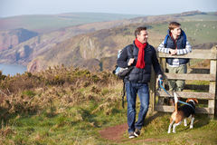 Father And Son With Dog Walking Along Coastal Path Stock Images