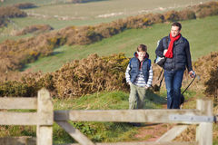 Father And Son With Dog Walking Along Coastal Path Royalty Free Stock Photography