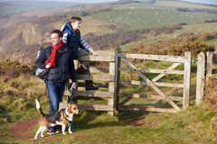 Father And Son With Dog Walking Along Coastal Path Stock Image
