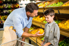 Father and son doing grocery shopping Stock Photo