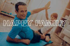Father And Son Are Doing A Gym. Sport Family. stock photography