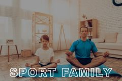 Father And Son Are Doing A Gym. Sport Family. Father And Son Are Doing Gym. Sport Family. Healthy Lifestyle. Active Holiday. Exercises Clothes. Getting Better Royalty Free Stock Image