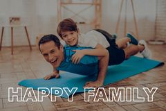Father And Son Are Doing A Gym. Sport Family. Father And Son Are Doing Gym. Sport Family. Healthy Lifestyle. Active Holiday. Exercises Clothes. Getting Better Royalty Free Stock Photo
