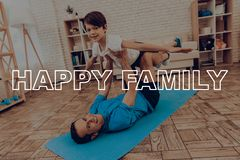 Father And Son Are Doing A Gym. Sport Family. Father And Son Are Doing Gym. Sport Family. Healthy Lifestyle. Active Holiday. Exercises Clothes. Getting Better Stock Photography