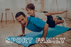 Father And Son Are Doing A Gym. Sport Family. Father And Son Are Doing Gym. Sport Family. Healthy Lifestyle. Active Holiday. Exercises Clothes. Getting Better Stock Photo