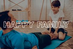 Father And Son Are Doing A Gym. Sport Family. stock images