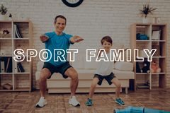Father And Son Are Doing A Gym. Sport Family. stock photos