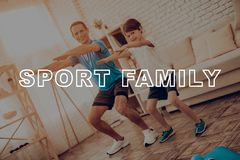 Father And Son Are Doing A Gym. Sport Family. royalty free stock photos