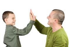 Father and son doing a high five. Over white background Royalty Free Stock Images
