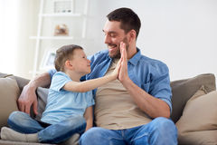 Father and son doing high five at home Stock Images