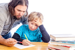 Father and son doing homework Royalty Free Stock Photo