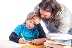 Father and son doing homework Stock Photos