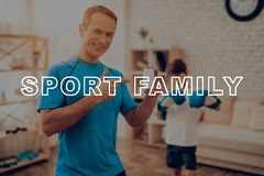 Father And A Son Are Doing Sports. Vitamin Box. royalty free stock photo