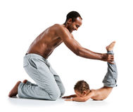 Father and son doing yoga Stock Photo