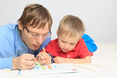 Father and son drawing family. Family concept Royalty Free Stock Photo