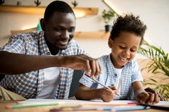 Father and son drawing together Royalty Free Stock Photography